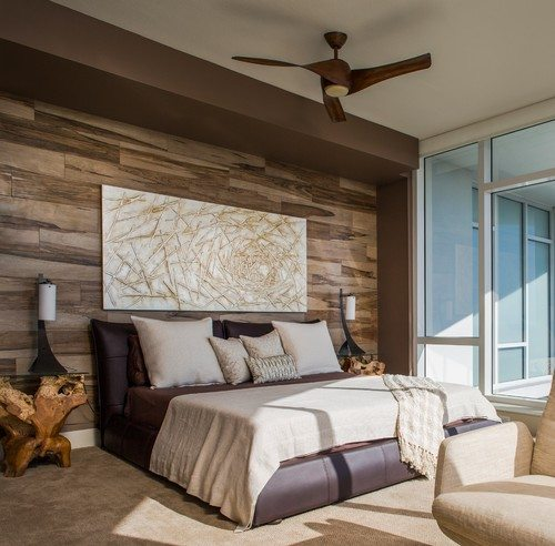 Bedroom with wood panel wall