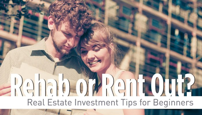 Young couple reading real estate investment pamphlet